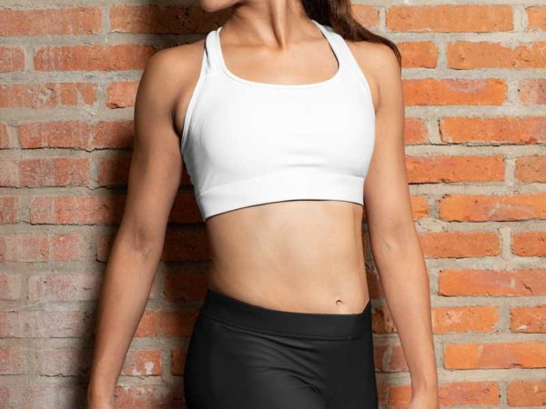 Adult Woman Wearing a White High Impact Sports Bra and Black Exercise Leggings from Swim Rags